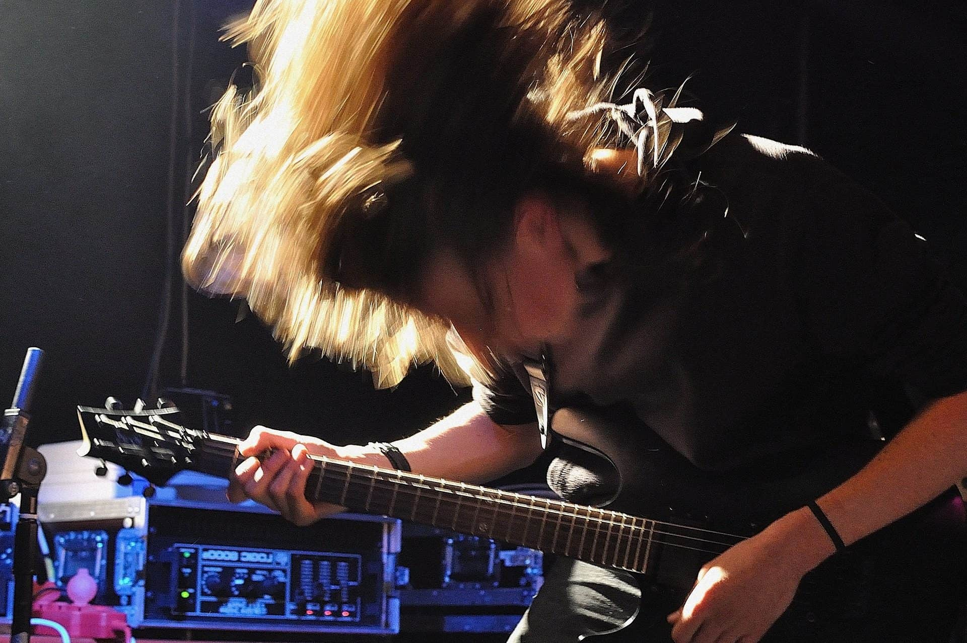 A rock guitarist in a heavy action shot